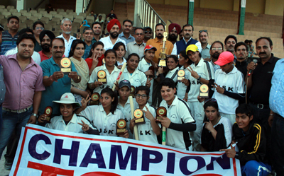 Jubilant J&K women team posing for a group photograph along with Member Parliament, Nazir Ahmed Lawey and Ranjeet Kalra, Member BCCI at MA Stadium in Jammu. -Excelsior/Rakesh