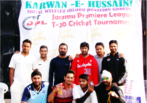 Players of Simula Cricket Club posing for group photograph after thrashing Young Cricket Club in Jammu on Friday.