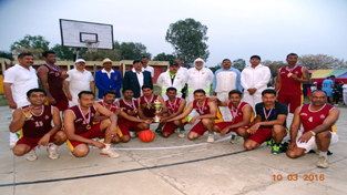 Winners of Inter-Battalion Frontier Level Basketball Competition posing for a group photograph alongwith chief guest and other dignitaries on Thursday.