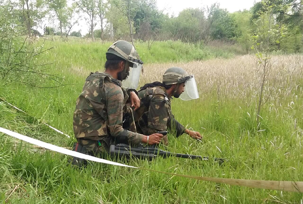 Army personnel engaged in de-mining operations at Lam in Nowshera sector of Rajouri district on Friday.