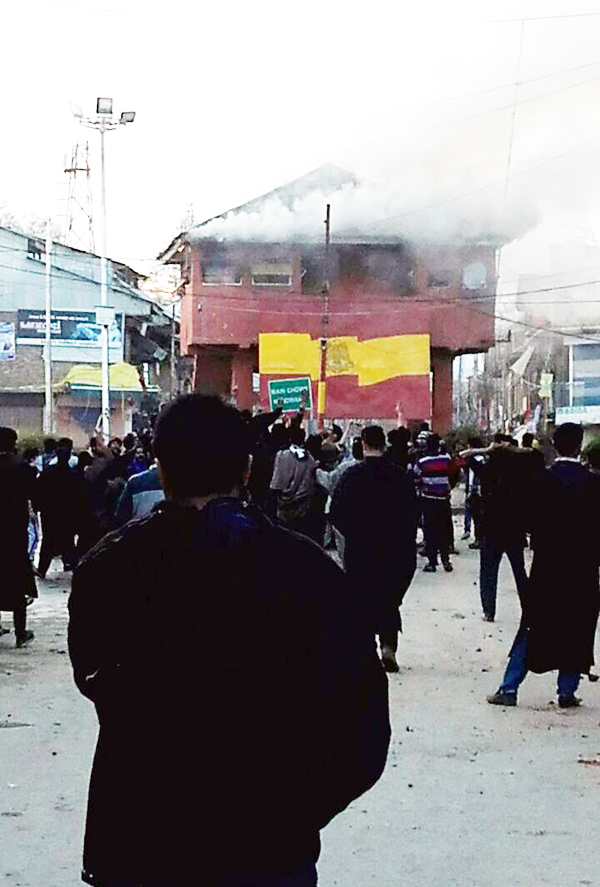 A view of a bunker torched by mob after Army opened firing on youth protesters in Handwara on Tuesday. - Excelsior Photo