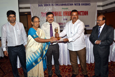 An entrepreneur being awarded by I&C Minister, Chander Prakash Ganga during 3rd COSIDICI National Awards Ceremony held at Jammu.