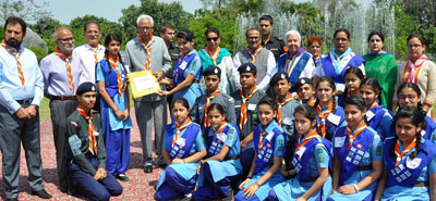 Governor alongwith other dignitories presenting Rajya Puraskar to Bharat Scouts and Guides at Raj Bhavan on Wednesday.
