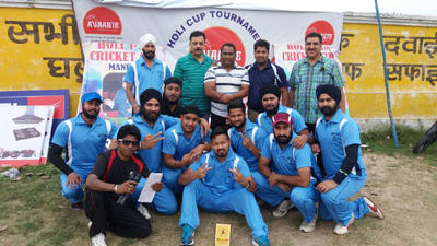 Winners posing along with organizers and officials at Mandal cricket ground in Jammu on Sunday.