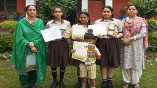 Winners of 'Gita Shaloka Competition' posing alongwith Principal and Teacher In-charge at Vishwa Bharati Public School in Jammu.