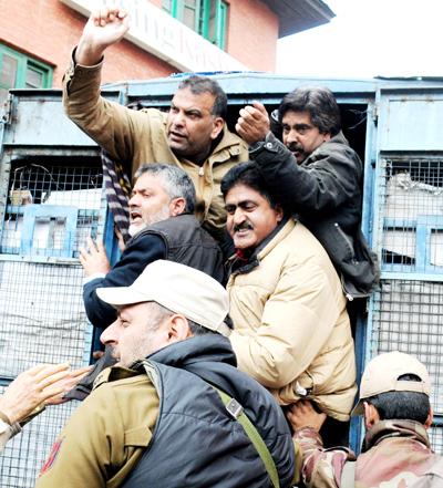 Policemen detaining agitating contractors at Srinagar on Tuesday.