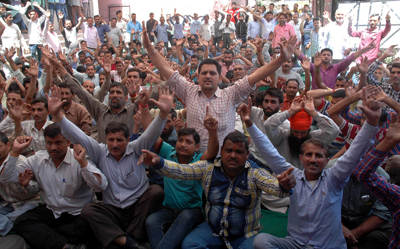 PHE daily rated workers sitting on protest dharna outside Chief Engineer's office in Jammu on Thursday. — Excelsior/ Rakesh.