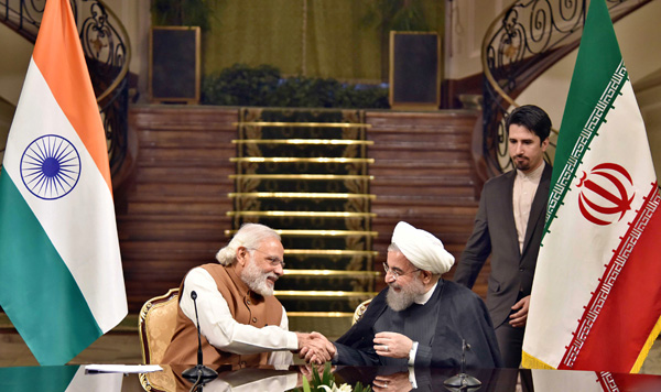 Prime Minister Narendra Modi and President of Iran, Hassan Rouhani during the joint press statement, in Tehran on Monday. (UNI)
