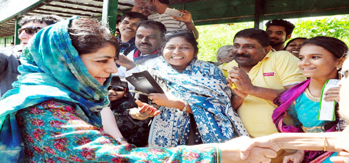 Chief Minister Mehbooba Mufti inter-acting with visitors at Gulmarg on Sunday.