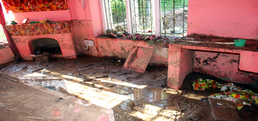 A house damaged due to flash flood after cloudburst in Kud area.