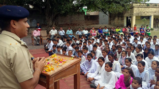 DIG Jammu Ashkoor Ahmed Wani addressing students at Government Higher Secondary School, Sumb.