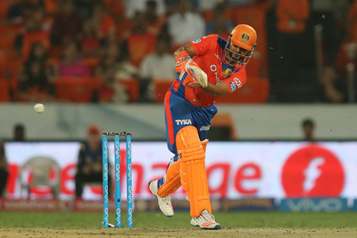 Gujarat Lions captain Suresh Raina flicks a delivery down the leg side to the boundary during a match against KKR at Green Park Stadium, Kanpur on Thursday.