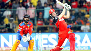 AB de Villiers of Royal Challengers Bangalore hitting a shot during match against Gujarat Lions at Bangalore.