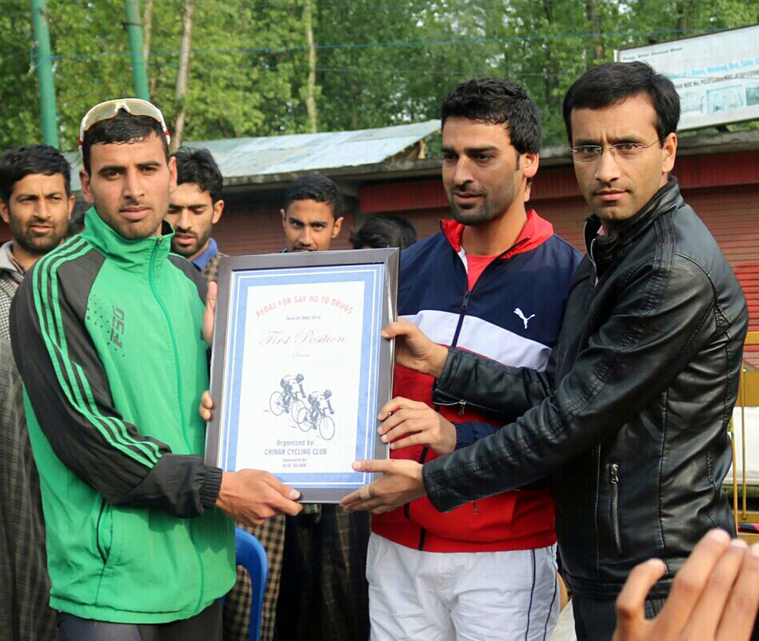 Ace cyclist Akbar being felicitated after clinching prestigious cycling title at Budgam on Thursday.