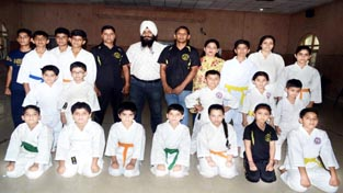 Selected Karatekas posing for group photograph.