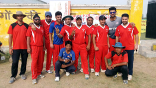Jubilant players of KCCC posing for a group photograph after beating RCC at Mandal in Jammu on Thursday.