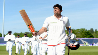 Alastair Cook raising bat after victory against Sri Lanka.