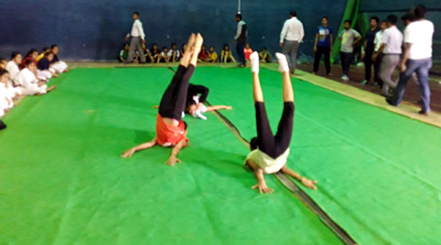 Gymnasts doing acrobats during a competition in MA Stadium, Jammu.