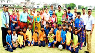 Winners of friendly football match posing alongwith Principal, staff members and parents at KC International School in Jammu.