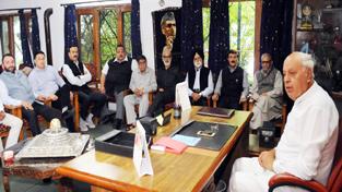 NC president Dr Farooq Abdullah presiding over the party meeting in Srinagar on Tuesday.