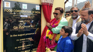 Minister for CAPD, Ch Zulfkar Ali inaugurating FCI godown at Rajouri on Sunday.