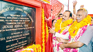 Minister for Rural Development, Abdul Haq Khan laying foundation stone of model village.