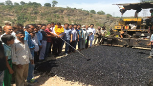 MLA Udhampur Pawan Gupta kickstarting black topping of road at Aasi on Sunday.