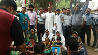 Panthers Party activists along with family members of martyrs during a protest at Exhibition Ground, Jammu.