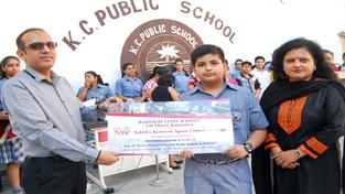 Ayushmaan posing for photograph with Principal Amarendra Mishra.