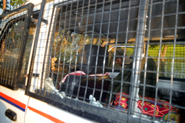 A police vehicle damaged in a militant attack at Bonagam in Anantnag district on Sunday. — Excelsior/Sajad Dar
