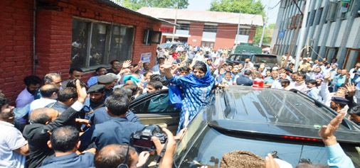 Chief Minister Mehbooba Mufti waves to crowd before filing her nomination papers in Anantnag on Wednesday. —Excelsior/Younis Khaliq