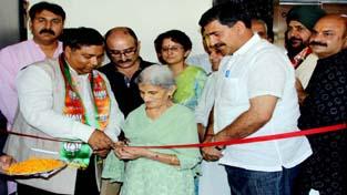 Geeta Devi, wife of former BJP President Vaid Vishnu Dutt dedicating BJP auditorium at Trikuta Nagar to late leader on Saturday.