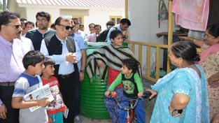 Advisor to Chief Minister, Prof Amitabh Mattoo during visit to Migrant Pandit Colony at Haal in Pulwama.