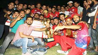 Players of AMS Stars Harwan posing for photograph after winning Harwan Cricket League title at Chandpora, Srinagar.