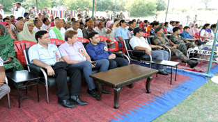 Army officers, Doctors and villagers listening to a lecture on prevention of diseases during medical camp.