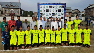 Winners of 'Corporate Football League Tournament' posing for group photograph at Chanapora, Srinagar.