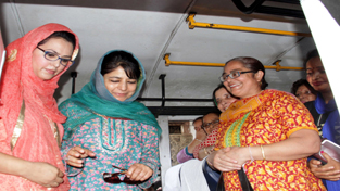 Chief Minister, Mehbooba Mufti amidst women folk during launch of Ladies Special Bus Service in Jammu on Saturday.