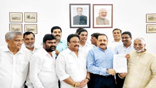 Union Minister Dr Jitendra Singh receiving a memorandum from a delegation of Telangana MPs at South Block, New Delhi on Tuesday.