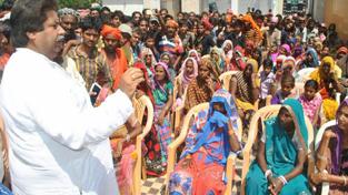 Senior Cong leader Raman Bhalla addressing public meeting in Gandhinagar area on Tuesday.