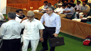 Former Chief Minister Omar Abdullah alongwith members of his party staging walk out from the Legislative Assembly on Monday.