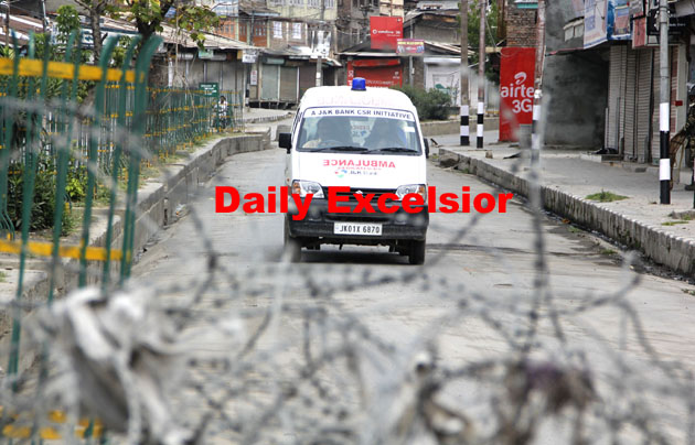 An Ambulance slows its speed for a security check at Khanyar Chowk.Excelsior/ Shakeel- Ul- Rehman