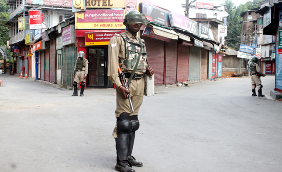 Para-military personnel guard Court Road in Lal Chowk area of Srinagar on Wednesday. —Excelsior/Shakeel