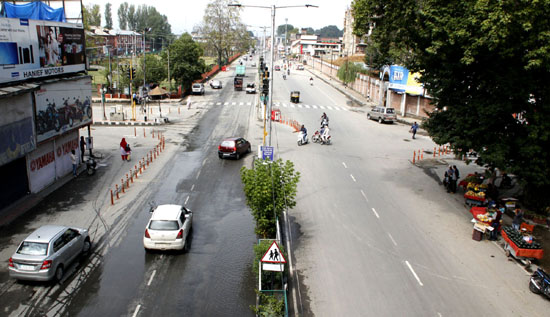 Few vehicles move on a Srinagar city road after curfew was lifted on Thursday. -Excelsior/ Shakeel