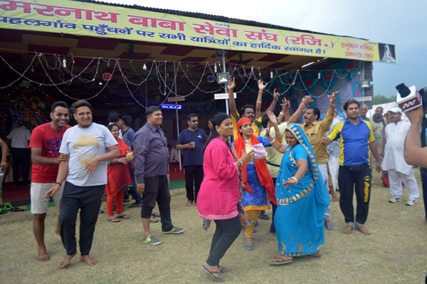 First batch of Amarnath yatris dancing at Nunwan base camp on Friday. —Excelsior/Sajad Dar
