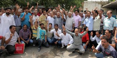 Protestors raising slogans during demonstration at Jammu on Wednesday. -Excelsior/Rakesh