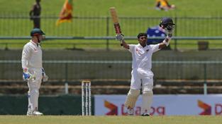 Kusal Mendis celebrating his century on 3rd day of Ist Test cricket match against Australia at Pallekele.
