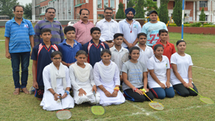 Students of MV International School, who won Badminton Singles and Doubles, posing with dignitaries.