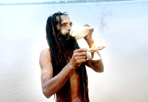 A Sadhu performing prayer after taking holy dip in river Ganges on the occasion of Guru Purnima in Mirzapur on Tuesday.(UNI)