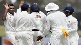 Ravichandran Ashwin celebrating victory with teammates after taking last wicket.