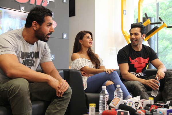 Bollywood actors John Abraham, Varun Dhawan and Jacqueline Fernandes during promotion of their upcoming film 'Dhishoom' in Ahmedabad on Wednesday. (UNI)